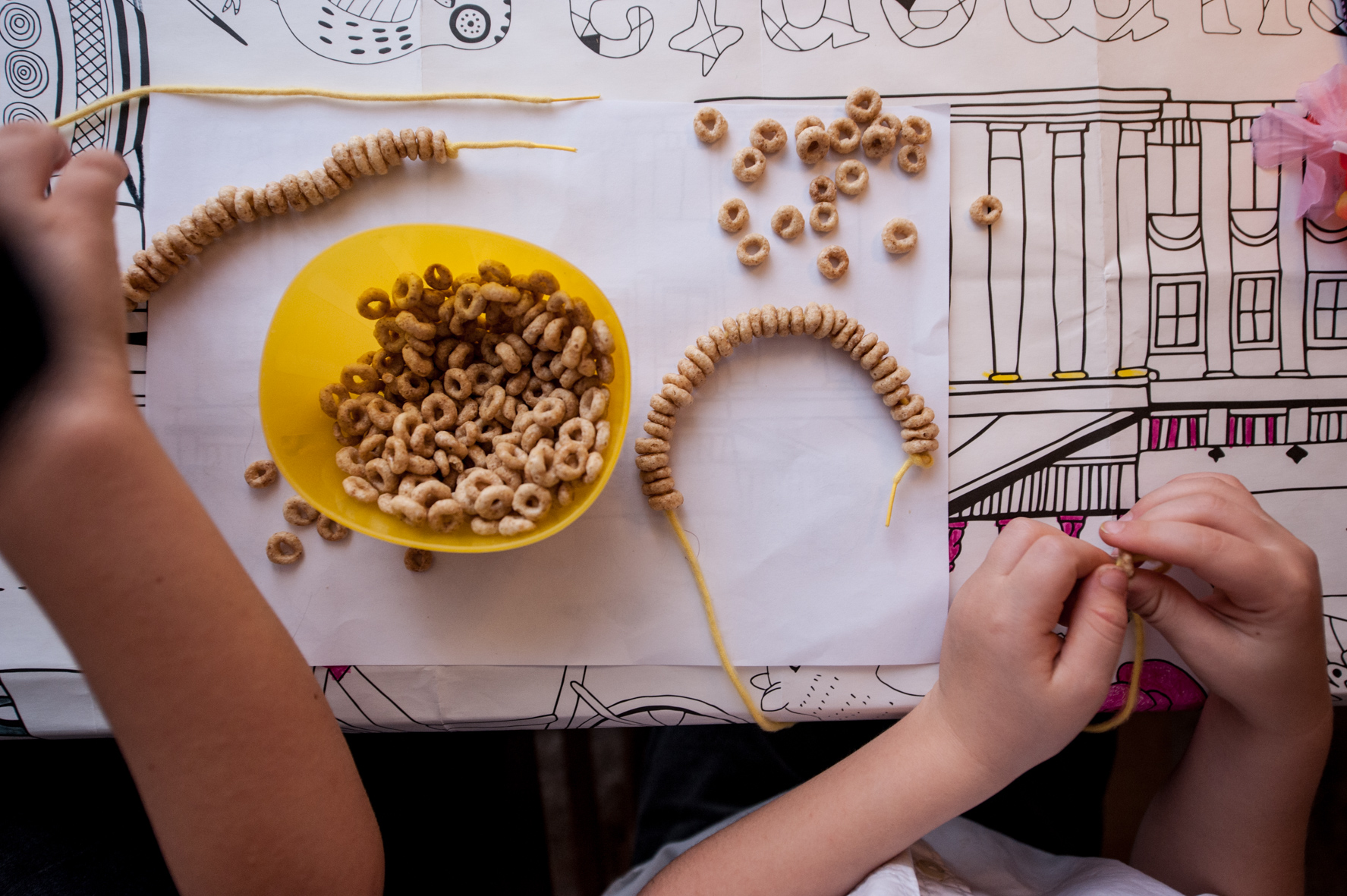 Threading cheerios - necklace in progress