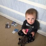 Toddler emptying mum's purse