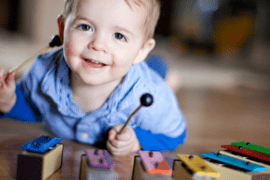 Image of baby playing chimes