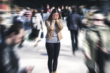 A woman grows anxious in a public crowd